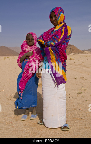 Colourfully dressed Tuareg women in the Sahara, Southern Algeria, North Africa - Stock Photo