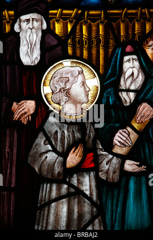 Jesus as a child in the temple with Mary and Joseph, 19th century stained glass in St. John's Anglican church, Sydney, - Stock Photo