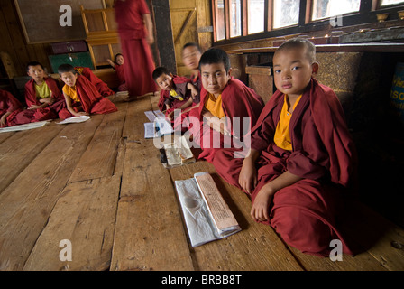 Group of young Buddhist monks learning, Chimi Lhakhang, Bhutan - Stock Photo