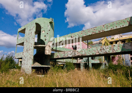 Destroyed old house full of bullet holes in the former war zone of Sarajevo, Bosnia-Herzegovina - Stock Photo