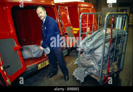 England East Sussex Brighton Mail Sorting Office Man Unloading Sacks Of Letters From Van And Placing On Trolley - Stock Photo