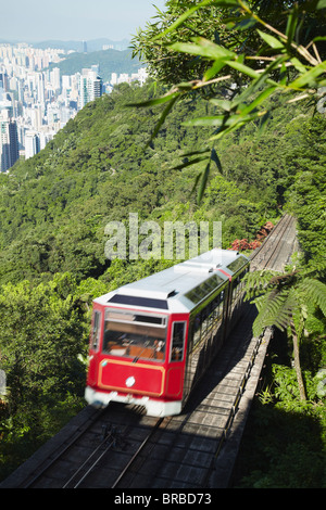 The Peak tram descending Victoria Peak, Hong Kong, China - Stock Photo