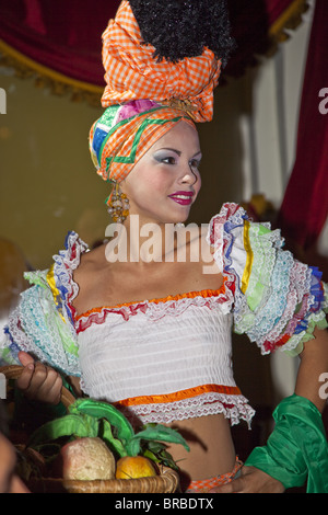 Woman dressed in colorful outfit at The Parisien Cabaret show in the National Hotel, in Havana, Cuba, West Indies - Stock Photo