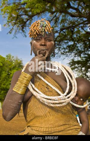 Woman of the Mursi tribe, Omo valley, Ethiopia - Stock Photo