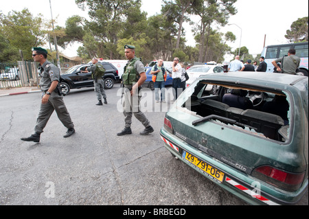 Israeli police guard the scene after Israelis were injured when their cars were attacked by Palestinians in A-Tur - Stock Photo