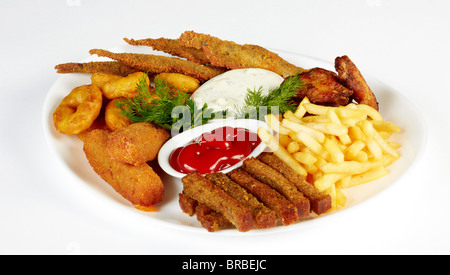 Roasted fish and chicken wings served with french fries and rusks isolated on a white plate - Stock Photo
