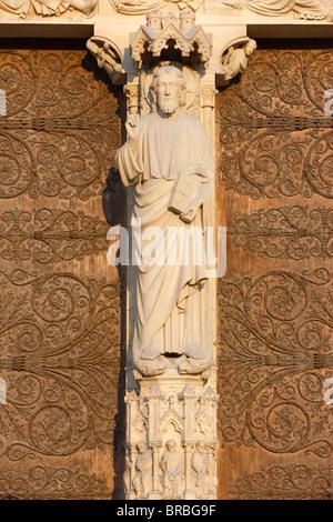 Christ sculpture, west front, Notre Dame cathedral, Paris, France - Stock Photo