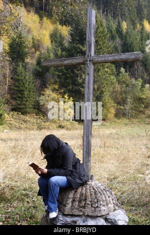 Bible reading, Les Contamines, Haute Savoie, France - Stock Photo