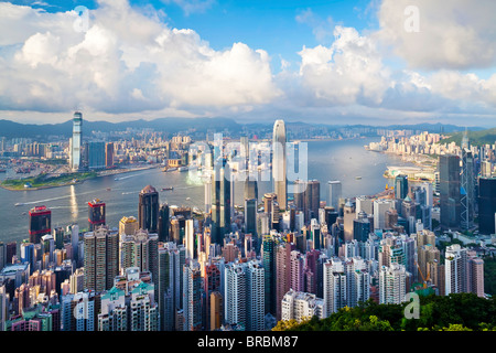City skyline and Victoria Harbour viewed from Victoria Peak, Hong Kong, China - Stock Photo