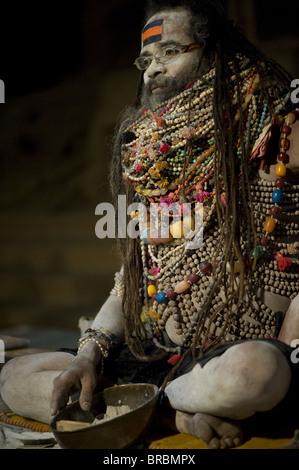 Lali Baba, wearing necklaces given to him to worship Shiva, Varanasi, Uttar Pradesh, India - Stock Photo
