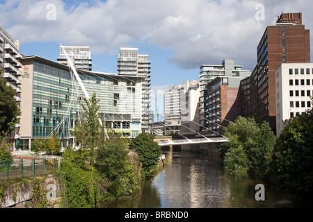Lowry Hotel  ( left) and Trinity Bridge over River Irwell,  Salford / Manchester border, Manchester, England, UK - Stock Photo