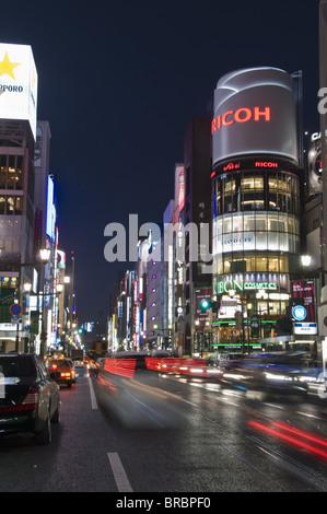 San-ai building and Chuo-dori at the intersection with Harumi-dori, Ginza, Tokyo, Japan - Stock Photo