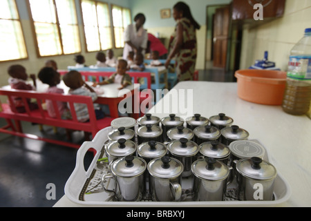 Meal time at a nursery and kindergarten run by Catholic nuns, Lome, Togo, West Africa - Stock Photo