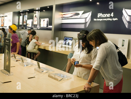 People trying out the iphone at the Apple Store, Fashion Show Mall, Las Vegas USA - Stock Photo