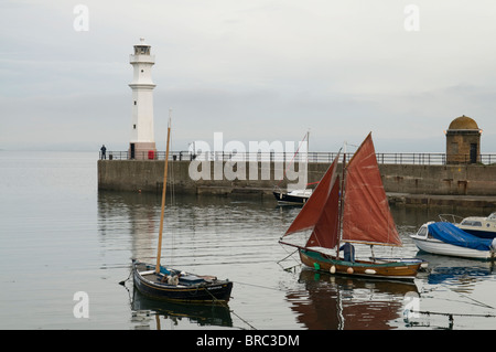 Small sailing boats in the early morning at Newhaven Harbour, Edinburgh. - Stock Photo