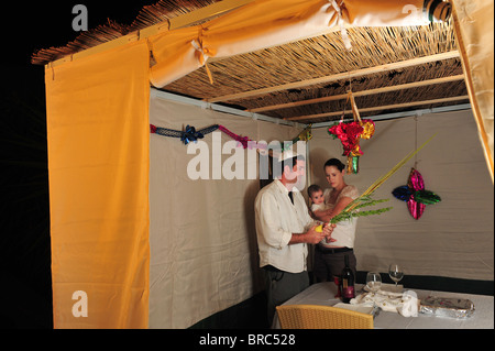 ... Jewish family celebrate Sukkot Jewish Holiday in a Sukkah in Israel during the Jewish festival of : jewish tent holiday - memphite.com