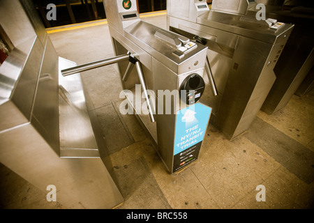 A New York subway turnstile equipped with a PayPass reader - Stock Photo