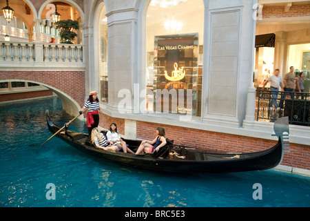 People having a ride on a gondola, the Venetian Hotel, the Strip, Las Vegas USA - Stock Photo