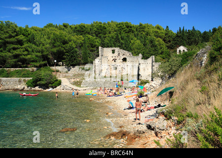 People on a beach at Bijar Bay in Osor, Cres Island, Croatia - Stock Photo