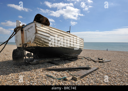 Beached fishing boat at Dunwich, Suffolk, England - Stock Photo