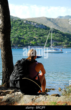 ZATON VELIKI, near DUBROVNIK, CROATIA. A female hiker resting and looking out over Zaton Bay. 2010. - Stock Photo