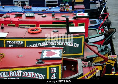 Moored narrowboats on Birmingham Canal by Gas Street Basin, Birmingham - Stock Photo