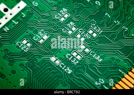 Close up of s green circuit board without components. - Stock Photo