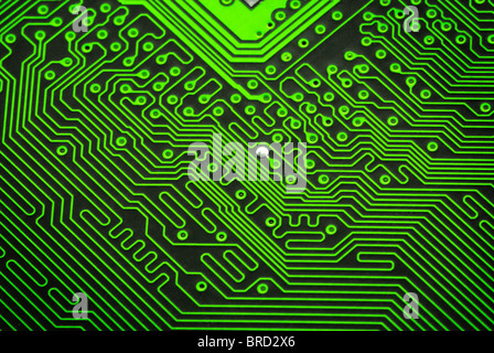 Close up of a red circuit board without components - Stock Photo