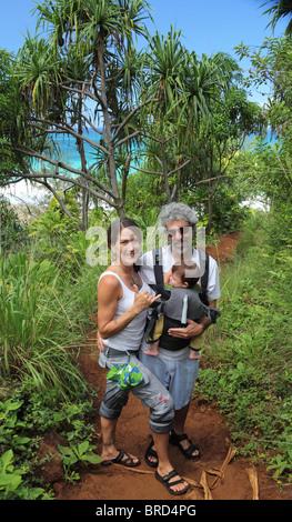 Couple with baby hiking the Kalalau Trail on Kauai - Stock Photo