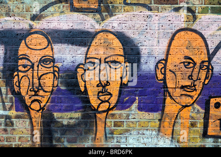 Graffiti on River Lee Navigation Canal towpath. East London, UK. - Stock Photo