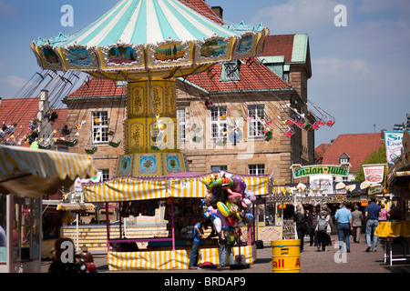 Merry-go-round and Festival stalls at May Week, Osnabrück, Lower Saxony, Germany - Stock Photo