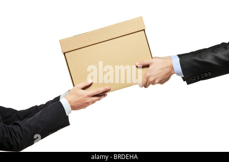 A businessman delivering a package to a man isolated on white - Stock Photo