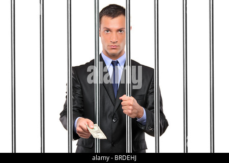 A businessman in jail giving bribe - Stock Photo