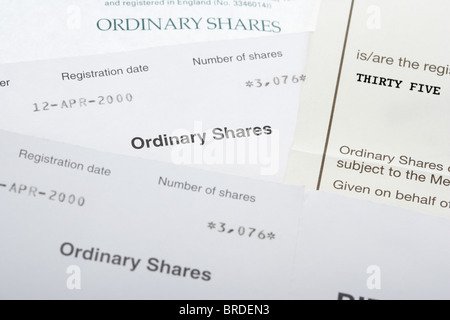 old style paper share certificate ordinary share certificates in the uk - Stock Photo