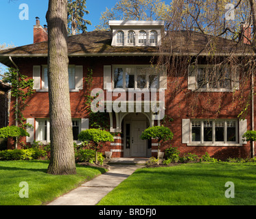 Beautiful large victorian family house springtime scenery in Canada - Stock Photo