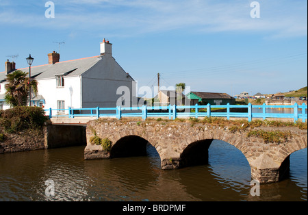 A pretty arched stone bridge over the river neet at bude in cornwall, uk - Stock Photo