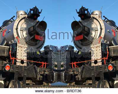 composite manipulated image 2 two train trains old antique steam driven locomotive locomotives looking at front - Stock Photo