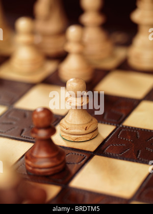 Two pawns on a chessboard - Stock Photo