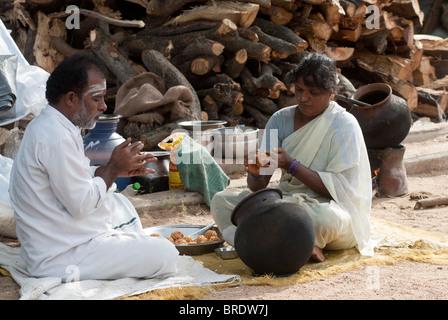 Preparing rice balls at Sevelimedu during Patukalam festival , Tamil Nadu. - Stock Photo