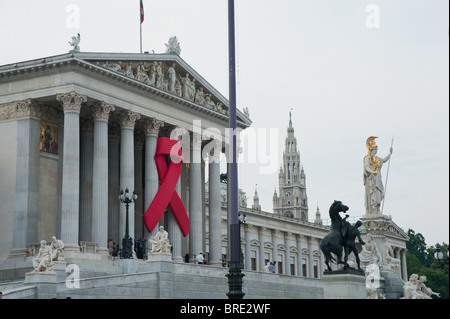 Wien, Parlament, AIDS-Schleife - Vienna, Parliament, Red Ribbon - Stock Photo