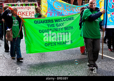Quakers with banner gay pride march - Stock Photo