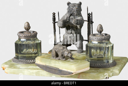 An eight-piece 'bear' desk set, circa 1900 Bronze, green marble, and crystal glass. Consisting of an inkwell rest, - Stock Photo
