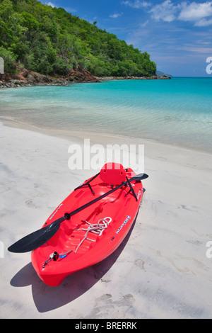 Red canoe at Megan's Bay. St. Thomas. US Virgin Islands. - Stock Photo