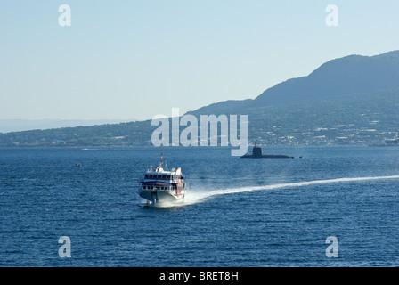 Yakushima Jetfoil Ferry returning to Kagoshima with Japanese Submarine and Sakurajima in Background, Kyushu, Japan - Stock Photo
