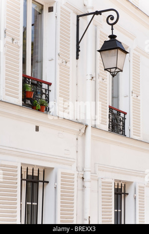Traditional houses with shutters on the windows in the Montmartre district of Paris, France - Stock Photo