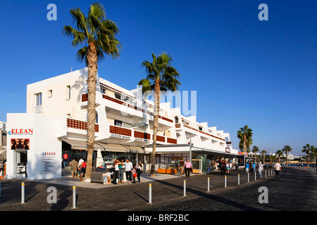 Shore promenade with people, shops, restaurants and palm trees, Kato, Paphos, Pafos, Cyprus, Europe - Stock Photo