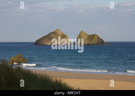 HolyWell Bay Cornwall on a sunny morning before the hordes arrive! - Stock Photo
