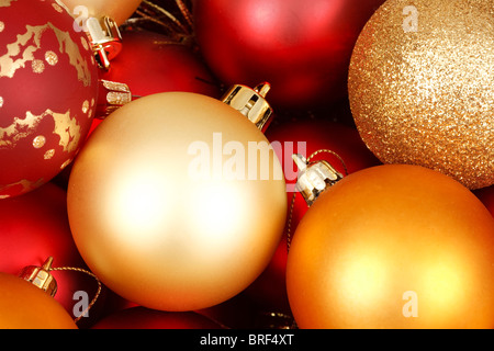 Colorful christmas baubles in red and gold - Stock Photo