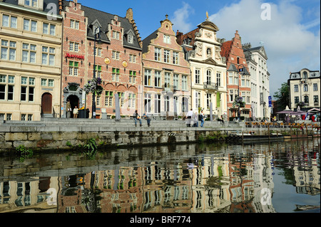Colourful buildings on the Korenlei overlooking the River Leie in the historic city centre of Ghent in Belgium - Stock Photo
