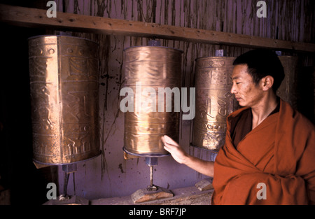 Tibetan Buddhist monk Dongyu, every morning after having spent time in the main Prayer Hall inside the monastery - Stock Photo